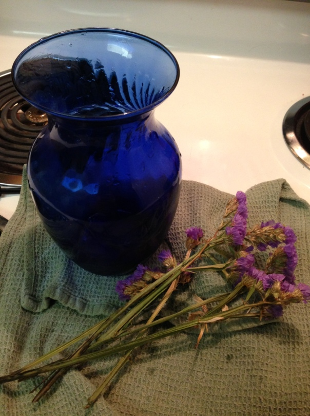 My abundance jar and some Lethe's Bramble (if you watch Buffy, straw flowers if you don't) from one of Gram's funeral bouquets. They dry so nicely I thought I would keep it.